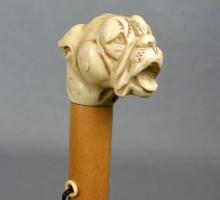 Parapluie pommeau en ivoire gravé, «le dogue», vers 1930